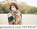 Autumn / winter image of young woman 56746587