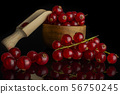 Fresh red currant isolated on black glass 56750245