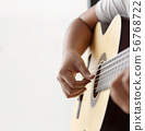 Woman hands playing acoustic classic guitar the 56768722