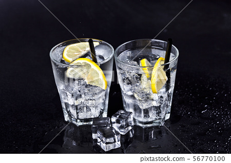 Glasses of fresh cold carbonated water with ice 56770100