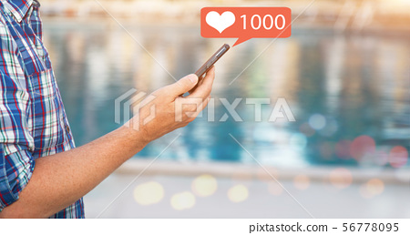Male hand holds a smart phone. 56778095