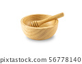 Honey scoop in empty wooden bowl isolated on white 56778140
