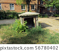 entrance to an abandoned bomb shelter in the yard. 56780402