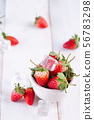 Fresh strawberries in a bowl on wooden table 56783298