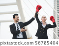 Business woman with red boxing gloves 56785404