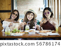 three asian woman ready to eating western food on 56786174