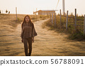 Asian travel woman walking on dirt road 56788091