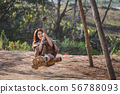 Travel asian woman relax on swing 56788093