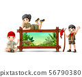 Scout boy and girl near the wooden frame 56790380