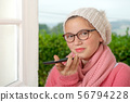 teenage girl in pink sweater talking with 56794228