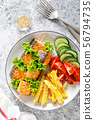 Grilled salmon kebab with potato and vegetables 56794735