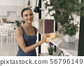Delighted woman during housekeeping at home stock photo 56796149