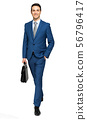 Full length of a handsome businessman holding a 56796417
