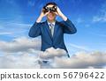 Giant businessman looking through binoculars above 56796422