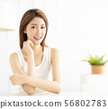 closeup smiling young asian woman in living room 56802783