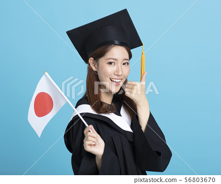 Happy asian female graduate student showing the 56803670
