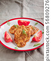juicy meat-chicken chops and tomatoes on a white 56809276