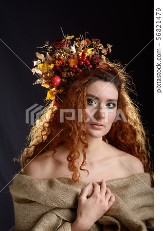 Portrait of young red haired caucasian woman with 56821479