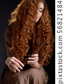Portrait of young red haired caucasian woman with 56821484