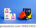 A forklift truck carries a red puzzle  56822403
