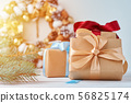 Christmas gift box with ribbon and decorations 56825174