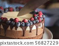 Fresh beautiful chocolate cake with fruit and berry 56827229