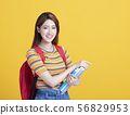 Portrait of beautiful asian young student holding 56829953