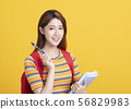 Portrait of beautiful asian  student holding books 56829983