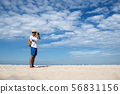 Young man travel outdoor on tropical beach with 56831156