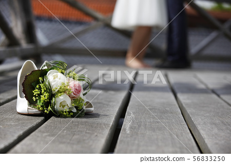 Bridal bouquet lying on the floor 56833250