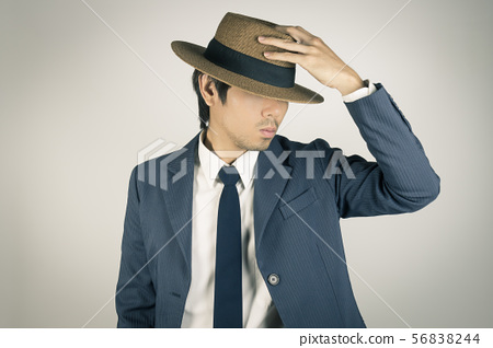 Young Asian Portrait Businessman Touch Hat and 56838244