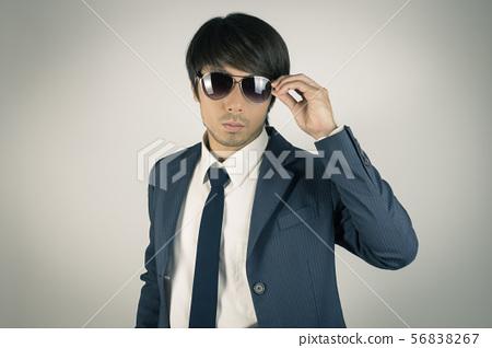 Young Asian Portrait Businessman Touch Sunglasses 56838267