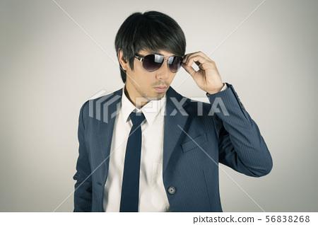 Young Asian Portrait Businessman Touch Sunglasses 56838268