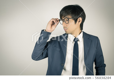 Young Asian Portrait Businessman Touch Eyeglasses 56838284