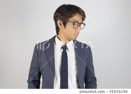 Young Asian Portrait Businessman in Navy Blue Suit 56838296