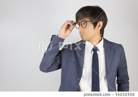 Young Asian Portrait Businessman in Navy Blue Suit 56838308