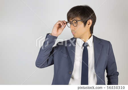 Young Asian Portrait Businessman in Navy Blue Suit 56838310
