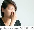 Woman pinch nose when scent bad smell. 56838815