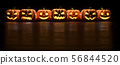 Seven Halloween Pumpkin glowing faces in a row isolated on black background. 3D Rendering 56844520