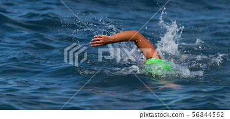 Arm of a swimmer athlete swimming in the ocean 56844562
