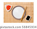 Empty round white plate with chopsticks for sushi 56845934