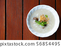 rice congee on wood table background 56854495