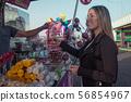 Woman buying popcorn at the fair 56854967