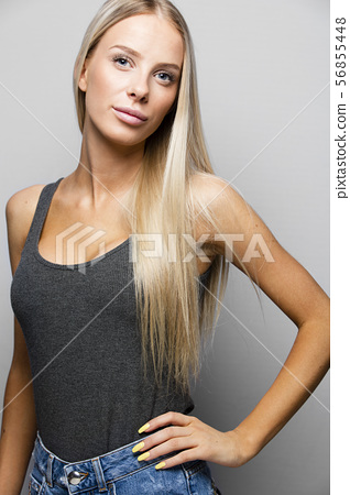 Fashion portrait of a confident and blonde young woman 56855448