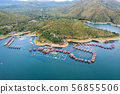 Wooden raft resort floating on dam with mountain 56855506