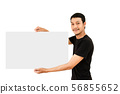 Happy young man showing and displaying placard 56855652