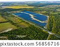 Aerial View of Solar Panels Field. 56856716