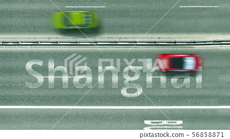Aerial down view of the motorway with cars revealing Shanghai caption. Car travel to China 3D 56858871