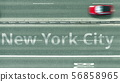 Aerial top down view of the road with cars revealing New York City caption. Car travel in the United 56858965