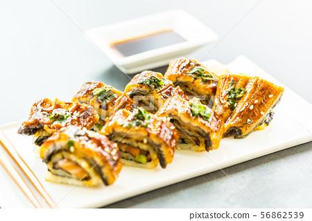 Grilled eel or unagi fish sushi maki roll with sweet sauce 56862539